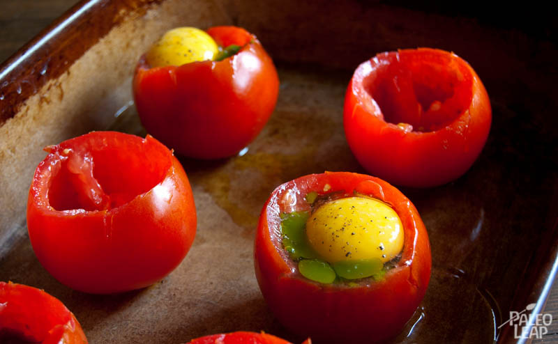Egg And Pesto Stuffed Tomatoes | Paleo Leap