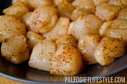 Sea scallops coated with spices