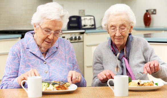 Senior women eating