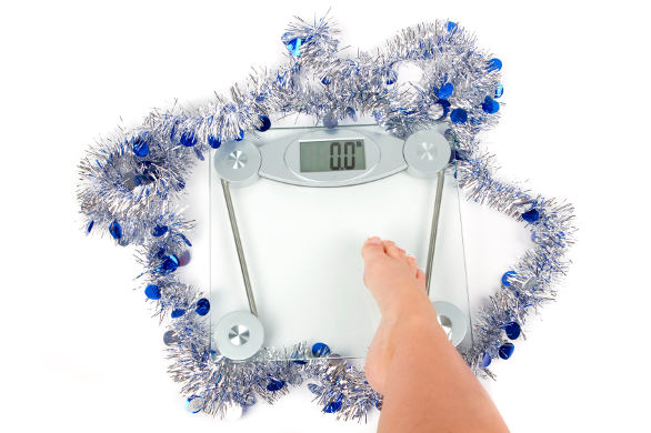 scale with tinsel