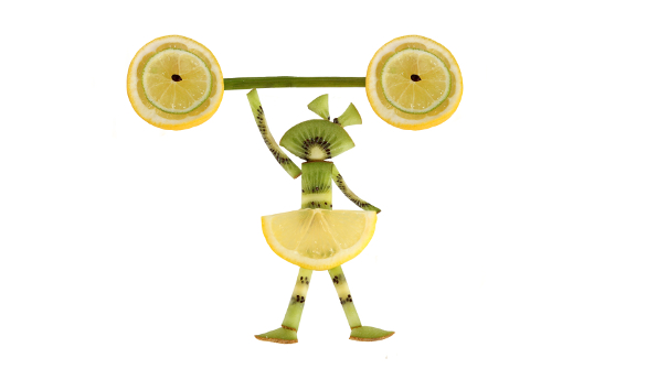 Fruit girl with a barbell