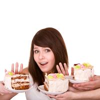 Woman refusing cake
